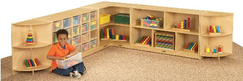 Two Curved Corner Storage Units Are Used In Above Arrangement, Along With  One Corner Storage Unit, A Cubbie Storage Unit And A Shelved Storage Unit.
